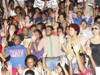 A Decatur rally organized via social media sites draws a large crowd protesting a police shooting in Ferguson, Mo. Photos by Andrew Cauthen