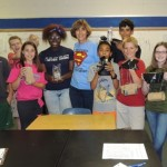 Kittredge Middle School science teacher Susan Oltman (center) is a finalist for the Presidential Awards for Excellence in Mathematics and Science Teaching. She leads her students in experience-based science projects, like these lunar landers students built.