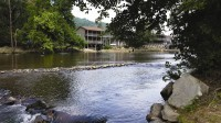 Oconaluftee Island Park is a popular spot in downtown Cherokee, N.C., that attracts those who like to picnic, fish and wade in the water. Photo by Gale Horton Gay