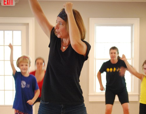 Debbie Liam, a Pine Lake resident, teaches the choreography for this year's Pine Lake Lakefest flash mob.