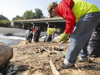 Workers remove trash from along South River as part of the federally-mandated cleanup. Photos by Andrew Cauthen