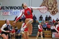 Dunwoody's Paige McKnight goes up to spike the ball.