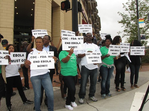 A group gathered in front of the CDC on Sept. 26 to raise the awareness of the Ebola crisis in West Africa. Photos by Andrew Cauthen