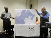From left, Ken Blakely and Tom Walton hold a map of the proposed south DeKalb city. Photos by Andrew Cauthen