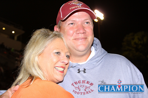 Tucker Tigers assistant football coach Robby Gilbert reunited with his birth mother Tish Myatt during halftime of his team's 55-0 victory over Alcovy. Photo by Travis Hudgons