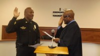 Lithonia Police Chief Roosevelt Smith is sworn in by Judge Curtis Miller.
