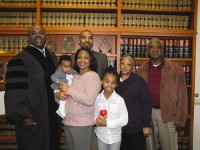 From left front, newly-adopted Karla, mother Jennifer, sister Jayla. From left back, Superior Court Judge Gregory Adams, Karla's father Brett and grandparents Barbara and James Moore.