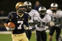 St. Pius running back Brian O'Reilly outrun Eastside defenders. Photos by Travis Hudgons