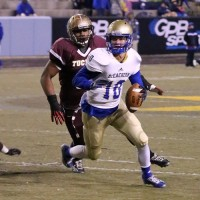 McEachern quarterback Bailey Hockman (No. 10) looks for a receiver down field while avoiding the pass rush.