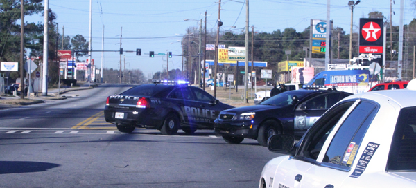 Officers blocking parts of Glenwood Road and directing traffic at the intersection at I 285. Photo by Travis Hudgons
