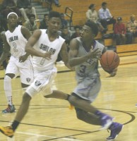 Miller Grove junior guard Alterique Gilbert hit his 1,000th point Dec. 9