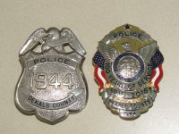 New badges have been distributed to DeKalb County Police officers to commemorate the department's centennial. Photo by Andrew Cauthen