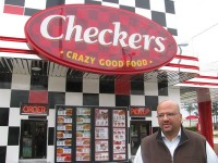 Franchise owner Saleem Lakhani shows his recently reopened Checkers on Lawrenceville Highway, which may be among the first in Georgia to feature the new logo design.