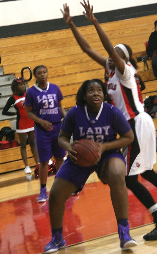 Miller Grove's Chrystal Ezechukwu (32) gets inside Druid Hills' Kayla Cato (3) for two of her 21 points.