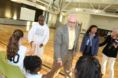 Decatur Mayor Jim Baskett greets players before the first youth game in the renovated Ebster Recreation Center.