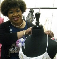 Enchanted Closet president and CEO Bonita Johnson examines one of the hundreds of dresses donated to be given to 2015 prom goers. Photos by Kathy Mitchell
