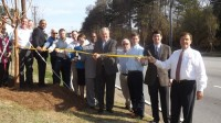Members of the Stone Mountain Community Improvement District (CID), DeKalb County officials and other partners cut the ribbon to celebrate the CID's beautification project.