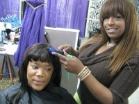 Styling a customer's hair, Black Butterfly owner Rita Patrick says there's more to operating a successful salon than making customers look their best.