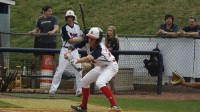 Dunwoody's Troy Anders goes in the to bunt the ball.