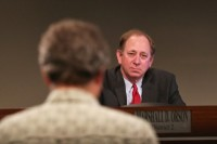 DeKalb County resident Chris Beck calls for board member Marshall Orson to step down. Photo by Travis Hudgons