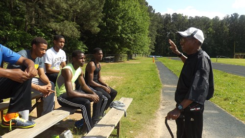 Southwest DeKalb track and field coach Napoleon Cobb motivates the track team during practice a week before the Class AAAAA state championship. Photos by Carla Parker