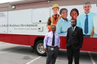 DeKalb Workforce Development assistant Donnie Cantley and the mobile center coordinator stand in front of the jobs bus. Photos by Ashley Oglesby
