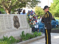 An officer stands in front of the fallen officer memorial outside the old courthouse in Decatur. Photos by Andrew Cauthen