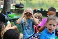 Camper Anderson Smith-Coat peers through binoculars for new discoveries.