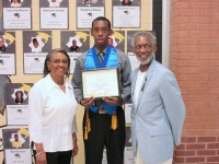 James L. Thornton's parents and memorial scholarship founders, Ora and Lovell, with 2015 scholarship recipient Leonard Simmons.