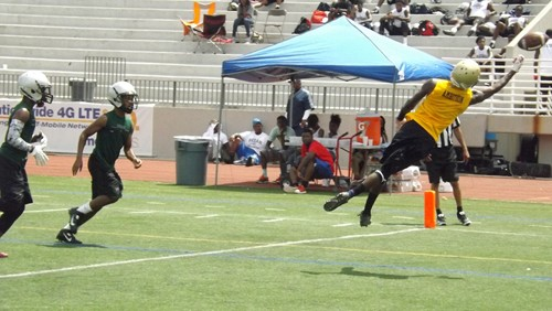 A ball is thrown out of reach of a Lithonia receiver (right) during the DTRL 7-on-7 tournament.
