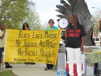 During a rally in April, activists voiced their concerns about the police-involved shooting of an unarmed, naked veteran. Photos by Andrew Cauthen
