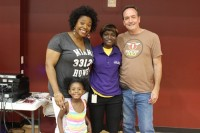 Praise 102.5 radio personality Veda Howard poses with program director Christin Taylor, Councilman Dean Moore and pre-K student Victoria Johnson.