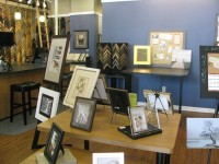 Owner Carolyn Shalosky shows the variety of possibilities in frames and mats. Photos by Kathy Mitchell