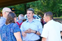 John Ernst (center) talks with supporters during his campaign kickoff cookout at Blackburn Park on Aug. 23. Ernst served as chairman of the DeKalb Board of Ethics from 2013 to 2015. Photos by Travis Hudgons