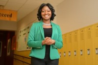 Newly appointed Executive Director Alisha Morgan stands in the halls of Ivy Preparatory Academy.