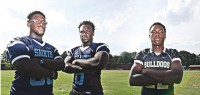From left, Cedar Grove defensive tackle Antwan Jackson and linebacker Elysee Mbem-Bosse, and Lithonia defensive end Jordan Smith are three of the top recruits in Georgia. Photo by Travis Hudgons