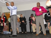 From left, DeKalb County District Attorney Robert James and Christopher Madden, a minister at DeKalb United Pentecostal Church, respond to a simulation used to train police officers.