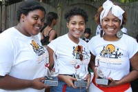 Carrie Salone, right, with her daughters Alleah, left, and Ayana hold awards that were presented to the honorees. Photos by Travis Hudgons