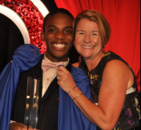Youth of the Year winner Brian Ball with President & CEO Missy Dugan.