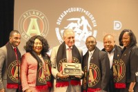 DeKalb commissioners pose with Atlanta United soccer team owner Arthur Blank in August to announce the now defunct deal. Photo by Ashley Oglesby