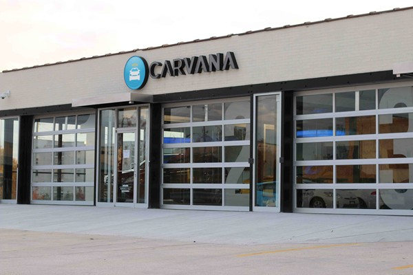 "Customers have the option of having their cars delivered to Carvana's ""vending machine.""  The Atlanta facility has offices and a three-car garage."