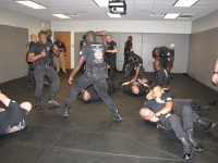 DeKalb Police recruits practice their skills earlier this year. Officers have vowed to fight for salary raises. Photo by Andrew Cauthen