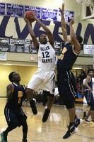 Miller Grove's Aidan Saunders goes up for a layup over Southwest DeKalb's Keith Gilmore.