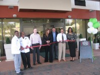 Members of the Holiday Inn team cut a ribbon to mark the facility's grand reopening.