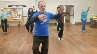 Stephen Dorage, center, leads a tai chi class at the Clarkston Community Center. Photos by Gale Horton Gay