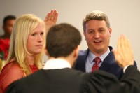 John Ernst is sworn in as Brookhaven mayor by Judge Mike Jacobs as his wife Monica looks on. Photos by Travis Hudgons