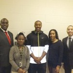 Alida Brown (second left) and Tyler Sylvester (center) were winners of an essay contest formed by Southwest DeKalb alums India Ali (second right) and Omari Crawford (far right).