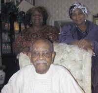 Rita Howey, left, and Norma Washington flank their 101-year old father at Washington's south DeKalb home.