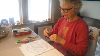 Adults coloring their way to relaxation