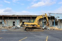 Demolition of the city-owned portion of the Lithonia Plaza began on March 14. Photo by Andrew Cauthen
